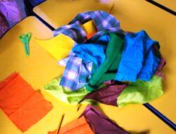 restos de tecido, tesoura e cola